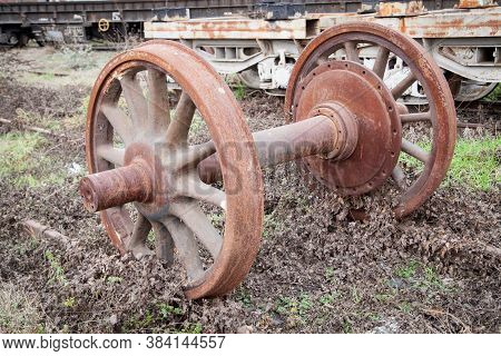 Old Rusty Wheels Of Train. Abandoned Old Train Station