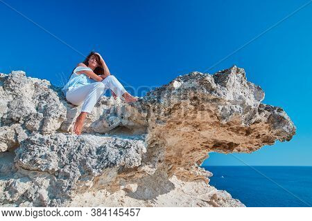 Beautiful Woman Posing Outdoors On Camera. Nature Landscape. Modeling Or Relaxation Idea. Seascape O