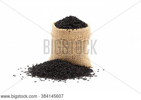 Black Sesame Seed In Sacks And Piles Sesame Seeds On White Background.