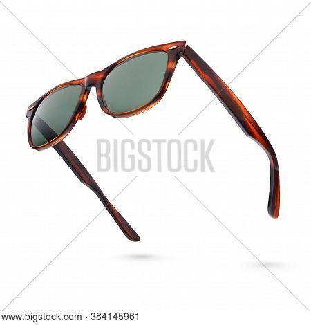 Vintage Tortoise Shell Style Plastic Sunglasses Isolated On White. Side View