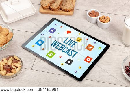 Healthy Tablet Pc compostion with LIVE WEBCAST inscription, Social networking concept