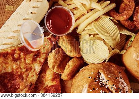 Unhealthy And Junk Food. Different Types Of Fast Food On The Table, Close Up