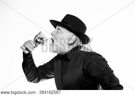 Bartender Enjoy Weird Cocktail. Delicious Cocktail For Brave Man. Bearded Old Guy Hold Wineglass Wit