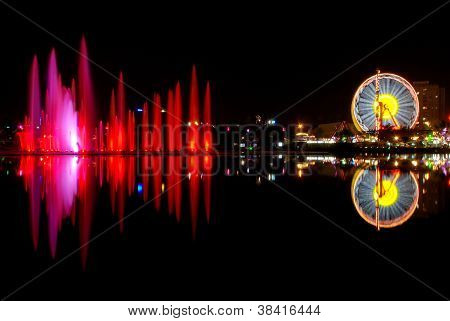 Luna park and city reflection