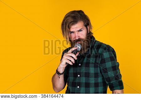 Singing In Karaoke. Mature Hipster With Beard Sing Song. Brutal Caucasian Guy With Microphone. Beard