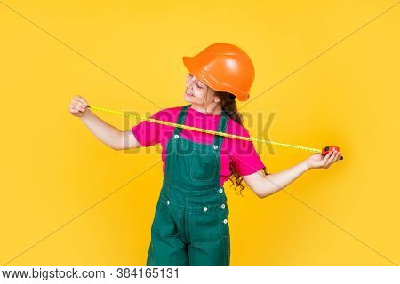Smart Professional. Building And Construction. Concept Of Repair. Little Girl Use Measuring Tape. En