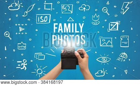 Hand taking picture with digital camera and FAMILY PHOTOS inscription, camera settings concept