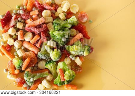 Mix Of Frozen Vegetables: Paprika, Carrot, Broccoli, Mini Corn, Tomato And Green Pea. Copy Space. He