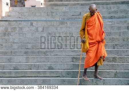 Bodh Gaya Bihar India On April 29th 2018 : Old Buddhist Monk Walking Down Through Stairs At Mahabodh