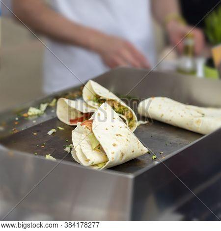 Fast Food Cooking. Portion Of Tortilla, Fajitas, Process Of Preparing. Concept Of National Food, Hea