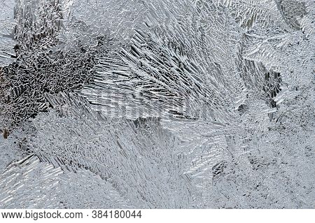 Ice And Frost On A Window Pane In Winter. Abstract Pattern. Crystals Of Frozen Water. Weather Foreca