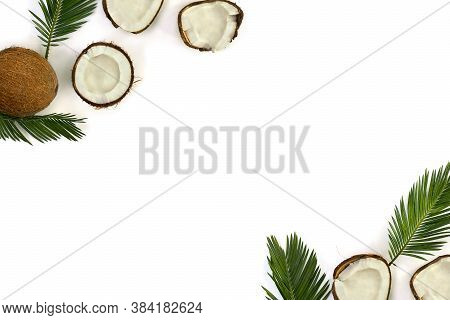 Coconut (cocos Nucifera) With Halves And Palm Leaves On A White Background With Space For Text. Top