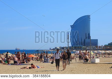 Barcelona, Spain - May 15, 2017: Unknown People Resting And Sunbathing On A City Beach. With View To