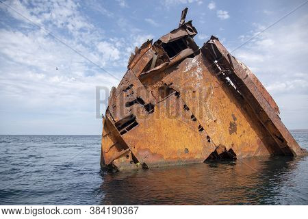 The Rusty Remains Of A Sunken Ship .