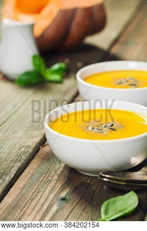 Healthy food cooking background. Vegetable ingredients and homemade soup.
