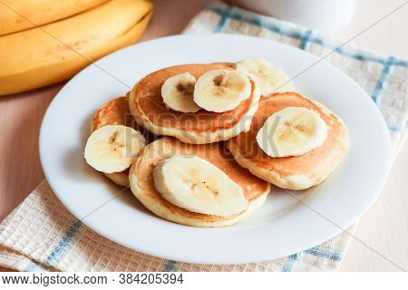 Pancakes With Banana For Breakfast On A Tray, Horizontal