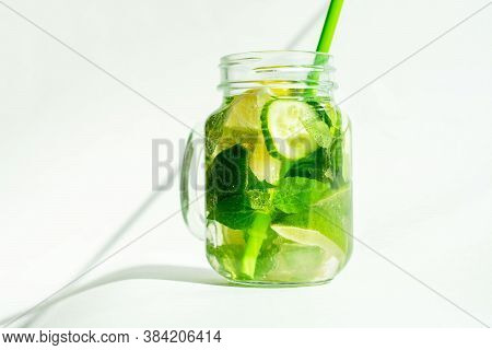 Health Care, Fitness, Healthy Nutrition Diet Concept. Fresh Cool Lemon Cucumber Mint Infused Water,
