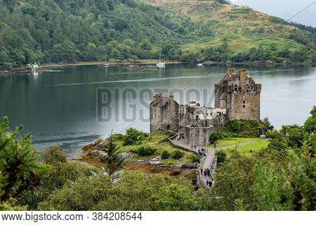 Eilean Donan Castle, Scotland, Uk In Waters Of Loch Duich Viewed From The Top Of The Hill Above Dorn
