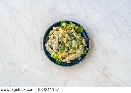 Sliced Artichoke With Broad Beans, Purslane Salad, Grated Parmesan Cheese And Olive Oil.