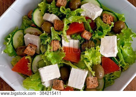 Greek Salad With Fresh Vegetables, Feta Cheese, Black Olives And Rusks.
