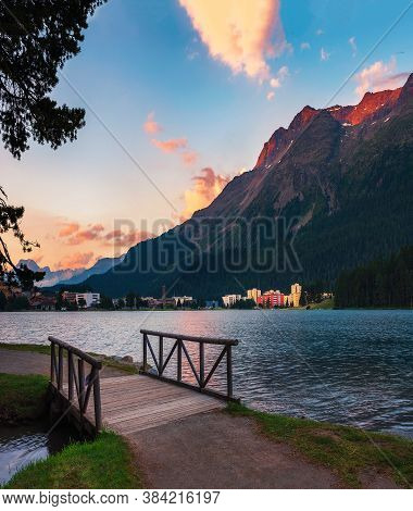 Sunset Above St. Moritz With Lake Also Called St. Moritzsee, A Wooden Footbridge In The Foreground A