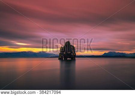 Colorful Sunset At The Hvitserkur Basalt Stack In Northern Iceland. Hvitserkur Is A Spectacular Rock
