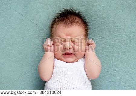 Portrait Of Crying Newborn Baby. Emotions Of