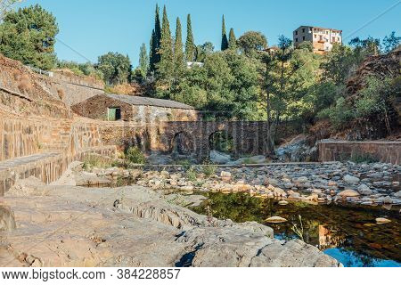 Roman Bridge And Natural Pool In Las Mestas, Caceres, Extremadura, Spain