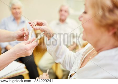 Seniors in painting therapy or occupational therapy in a retirement home