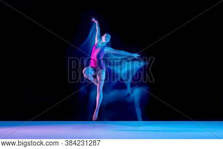 Smoke. Young And Graceful Ballet Dancer On Black Studio Background In Neon Mixed Light. Art, Motion,