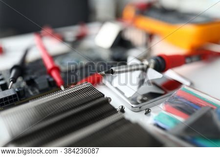 Close-up Of Red Sticks For Measuring Electrical Voltage. Repair Computer Mainboard Using Digital Mul