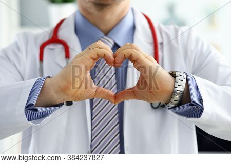 Male Medicine Doctor Hands Showing Heart Shape Closeup. Medical Help Prophylaxis Or Insurance Concep