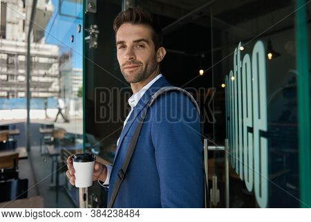 Young Businessman Buying A Coffee For His Morning Commute