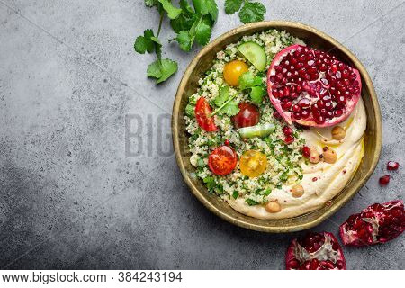 Rustic Bowl With Couscous Salad With Vegetables, Hummus And Fresh Cut Pomegranate. Middle Eastern Or