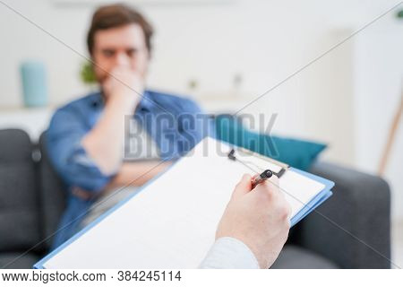 Psychologist Doctor Taking Notes During Psychotherapy Session