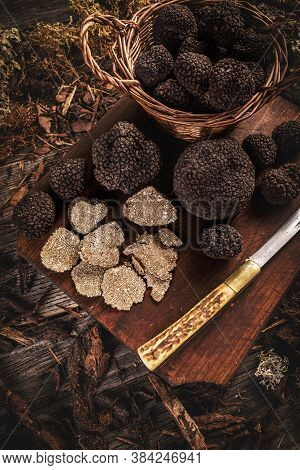 Whole And Slice Of Delicacy Black Truffles Mushroom