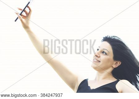 Pretty Young Happy Woman Making Selfie On Smartphone.