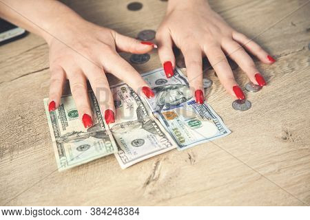 Beautiful Woman Hands, Counting Hundreds Of Dollars On Dark Wood Tables