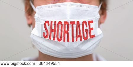 Covid-19 Shortage Theme With Person Wearing A Protective Surgical Face Mask