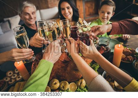 Cropped Photo Of Family Relatives Meet Sit Served Dinner Table Hands Hold Wineglasses Golden Wine St
