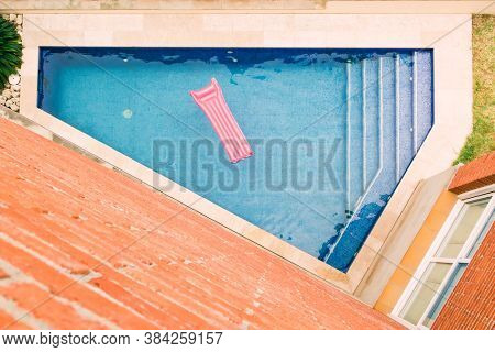 top view of Inflatable mattress floating in swimming pool