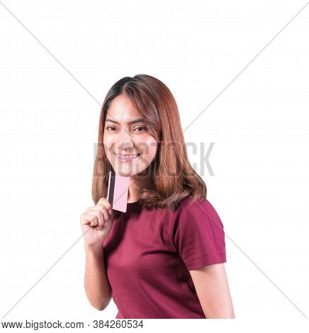 Woman Dental Braces Smile Holding Credit Card. Closeup On White Background