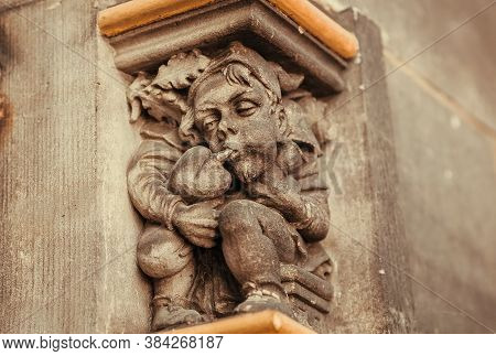 Bremen, Germany: Peasant Playing Music On Bagpipes, Sculpture On Column Of The15th Century Rathaus B