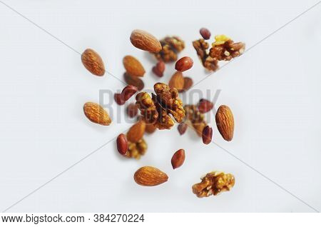 Nuts In The Air On A White Background, Flying Nuts. Healthy Brain Food, Diet, Protein, Almonds, Waln