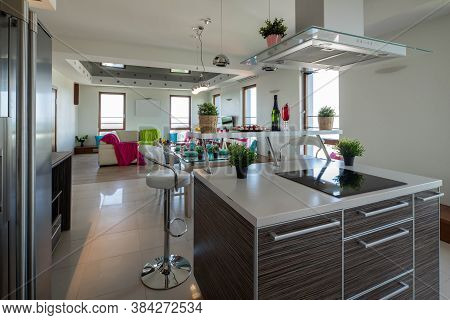 Luxury Studio Apartment. Living Room And Kitchen With Laid Table. Kitchen Set.