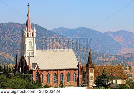 September 5, 2020 In Virginia City, Nv:  Historical Cathedrals On A Hillside Overlooking Arid Mounta