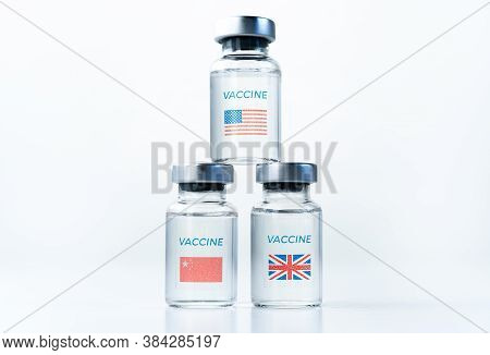 Transparent Vials With Usa, Uk, China Flag. New Vaccine For Covid-19 Coronavirus, Flu,infectious Dis