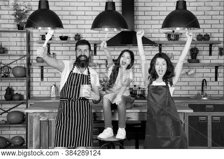 Friendly Family. Mother Father And Daughter Cooking Together. Tasks And Duties. Child With Parents C