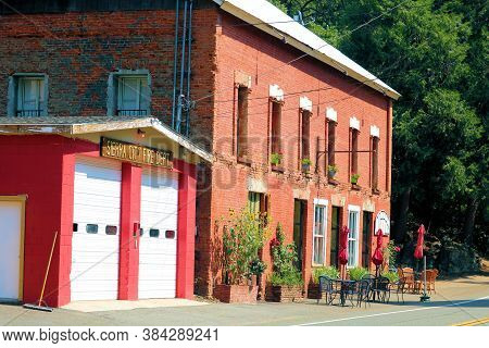 September 3, 2020 In Sierra City, Ca:  Historical Brick Building Besides The Fire Station Taken In T