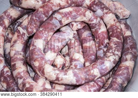 Making Homemade Sausage At Home. Stuffing Pork Intestine With Meat And Fat. The Photo Shows The Stag